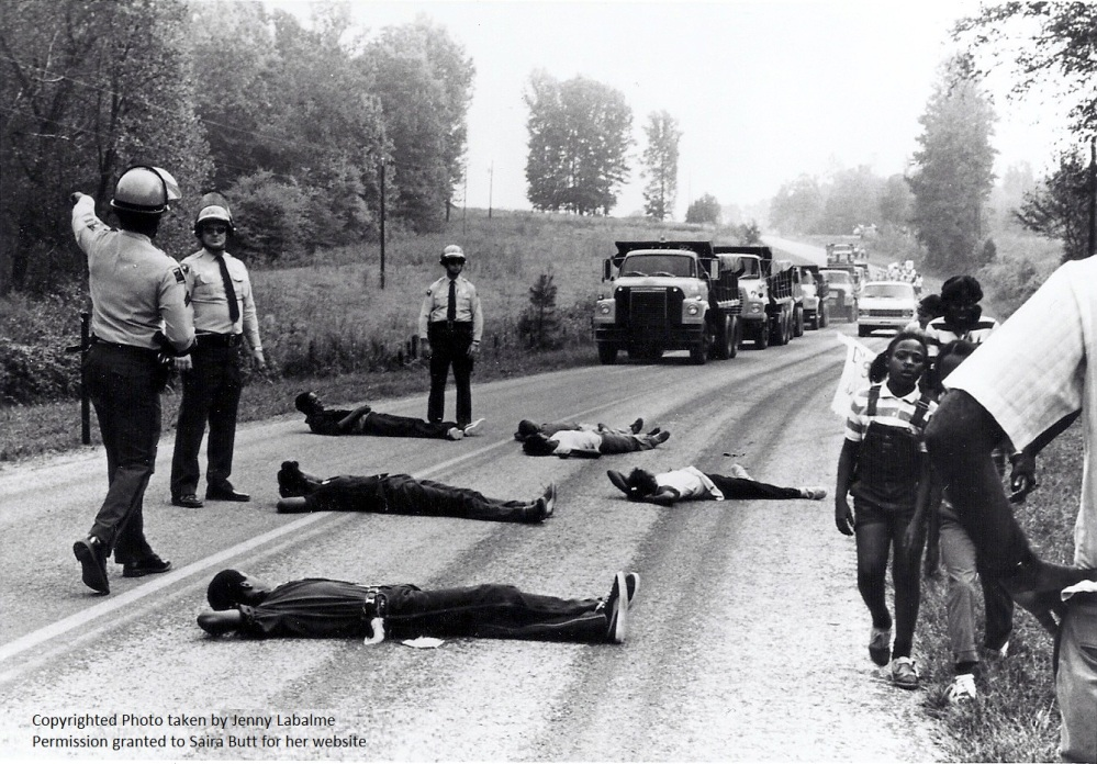 Protesters lying down in front of advancing dump trucks in Warren County, NC. Source: Duke University.