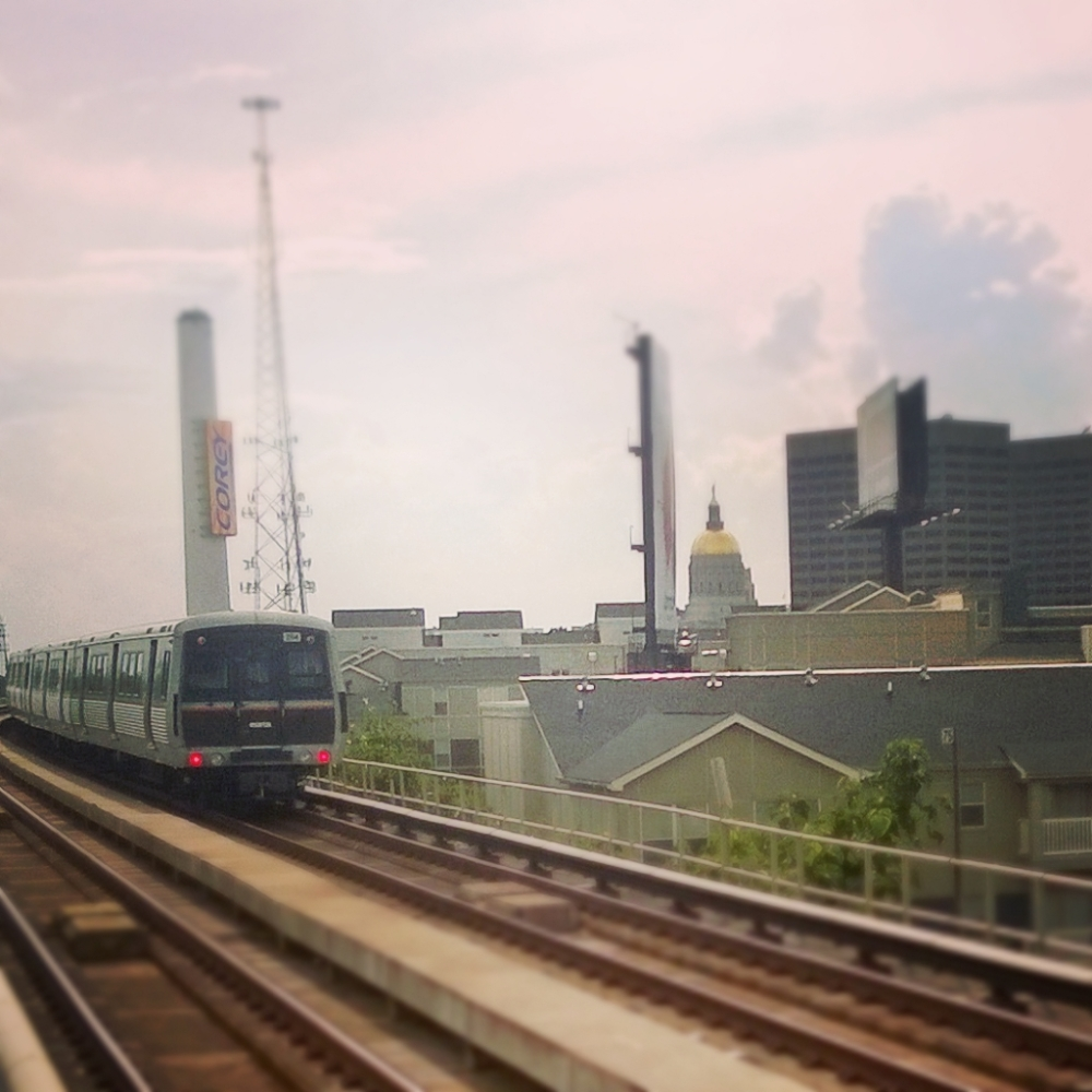 A MARTA train pulls out of the King Memorial Station, heading West towards Georgia's golden dome.